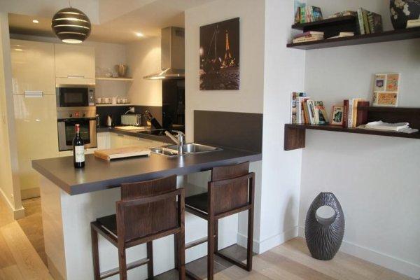Cuisine au design pur et aux coloris incontournables for Le decor de la cuisine