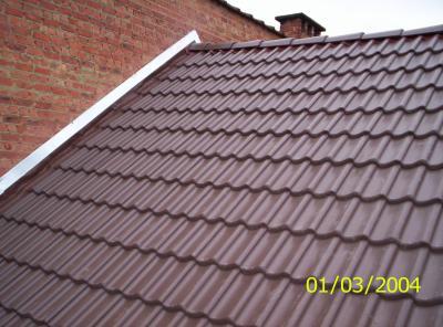 Final toiture tuile sneldek brun degreef toiture for Pose toiture tuile