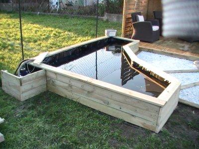 Petit bassin pour poisson images for Bassin a poisson en bois