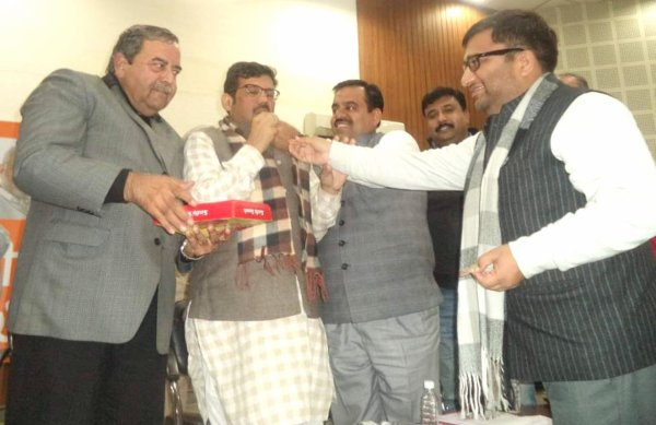 BJP Leaders offering sweets to State President Kamal sharma as membership drive crosses 5 lacs mark in a month at party head office in Chandigarh.