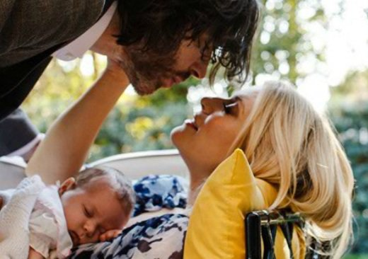 Paul Bryan leans to kiss his daughter's mother, Emily Procter