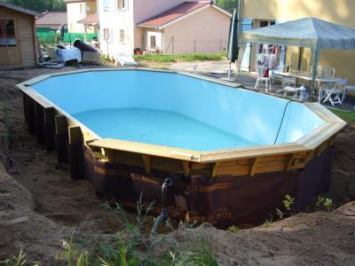 Remplissage et remblais construction d 39 une piscine bois for Construction piscine 974